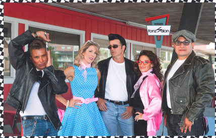 "Aimee with the staff of Fonz Salon in their ""Grease"" costumes!"