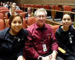 Dr. Christian with Interns Ciindi Montanya and Krystle Riojas at the Holly Auditorium
