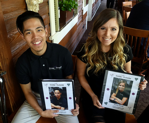 Matt & Jaclyn at their going away lunch at Aldo's with their book of memories of their internship