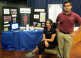 Staff Member Ely Ybarbo and UTSA Intern Drew at our DXA Display during Rowdy Week!